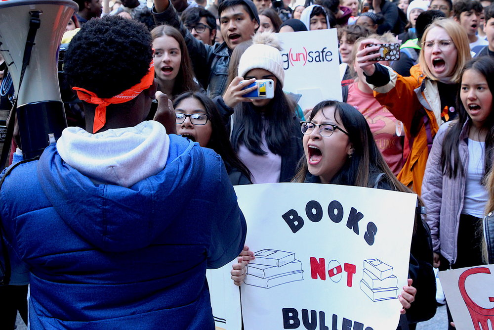 Students took to the streets of Chicago to protest in solidarity with students nationwide as they ask for an end to gun violence