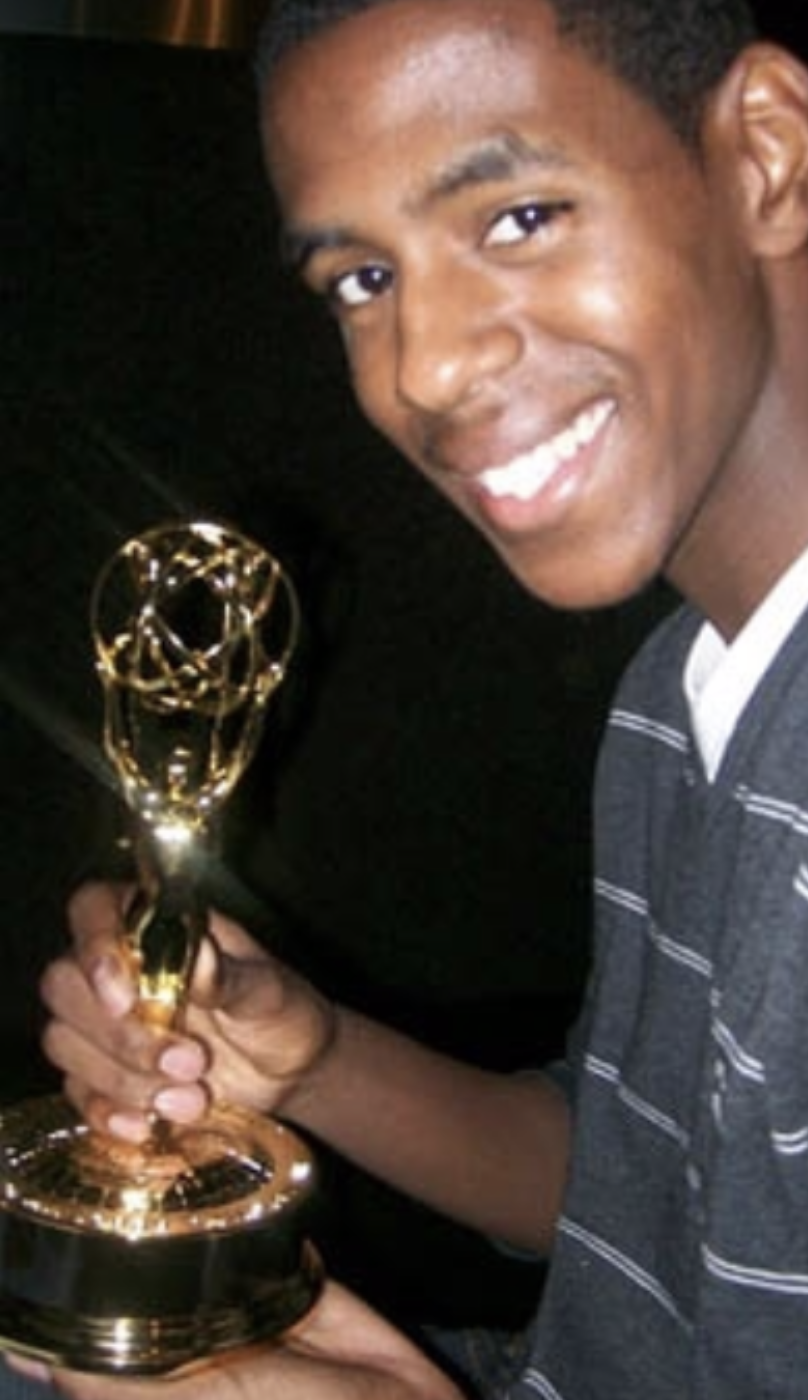 Montel Williams holding the Emmy