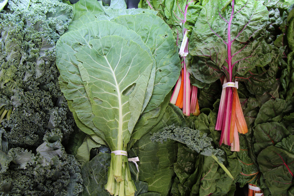 Bunches of collard greens sell for $1 per bunch.