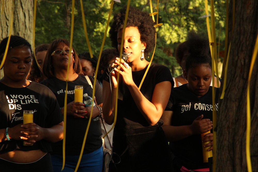 Candle lit memorial tribute to Rekia Boyd led by Jamila Woods