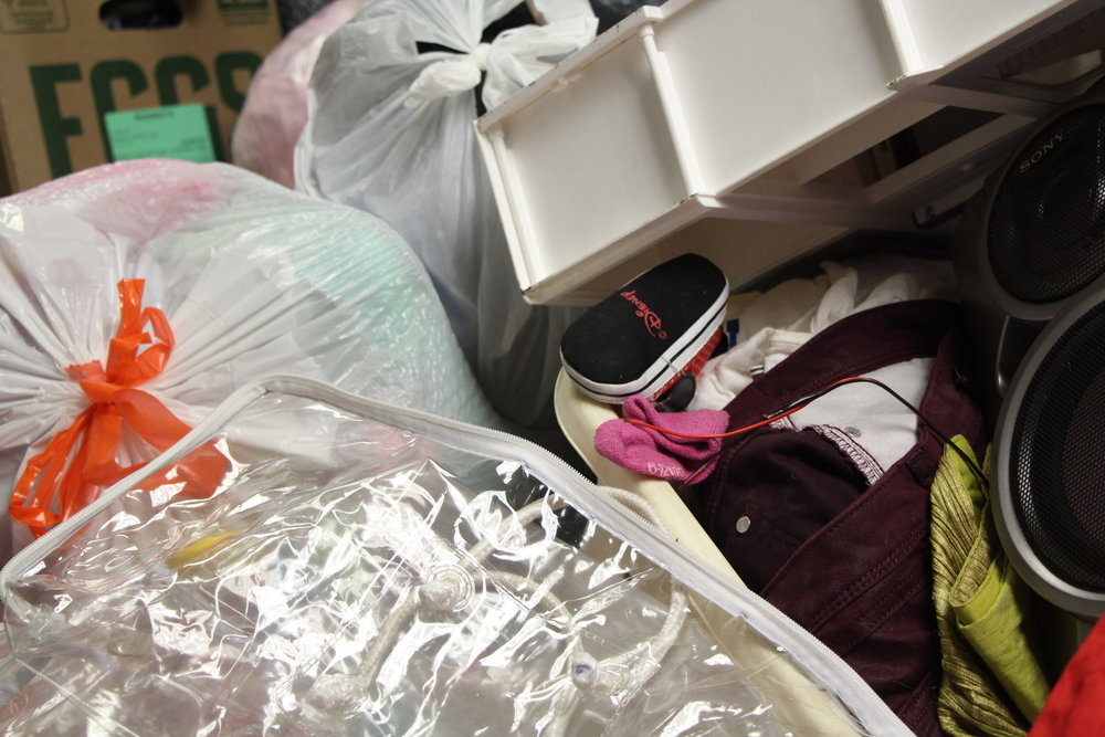 A baby shoe lies among the donations gathered at Amor De Dios church for the families affected by the Little Village fire that took place Aug. 26.