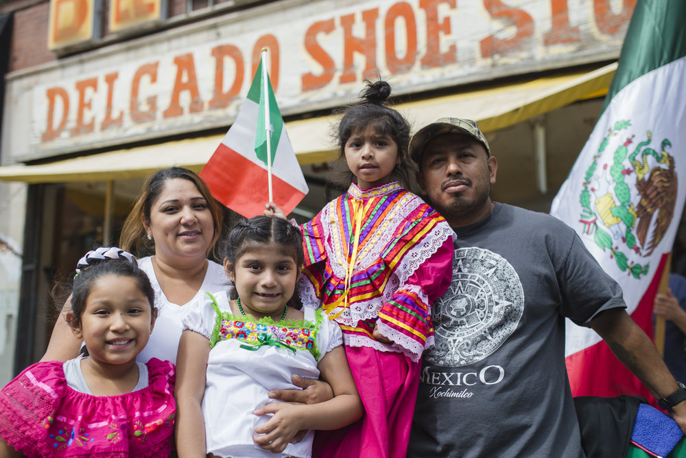 "Lorena Sanchez with Uriel Hernandez, Mia, Milendy and Melanie Hernandez. ""I grew up here in Little Village. I think it's just tradition, you know, from me being a kid to bringing my kids now that, you know, we're not living in the area, but bringing them back to our culture,"" said Sanchez who believes that families belong together because that's how culture is passed down. ""I think that the family is a culture, you know. There is no family, there is no culture. You have to belong to a family so that you can have a culture."""