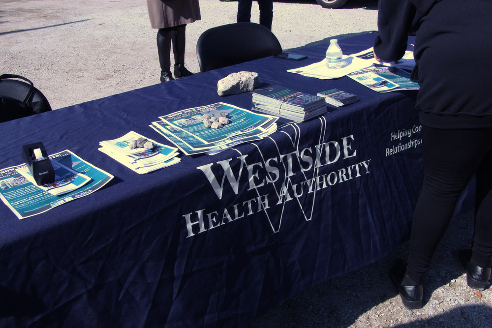 "The Westside Health Authority's table had flyers promoting the ""Know Your Rights"" trainings and pamphlets with information about the resources that they provide."