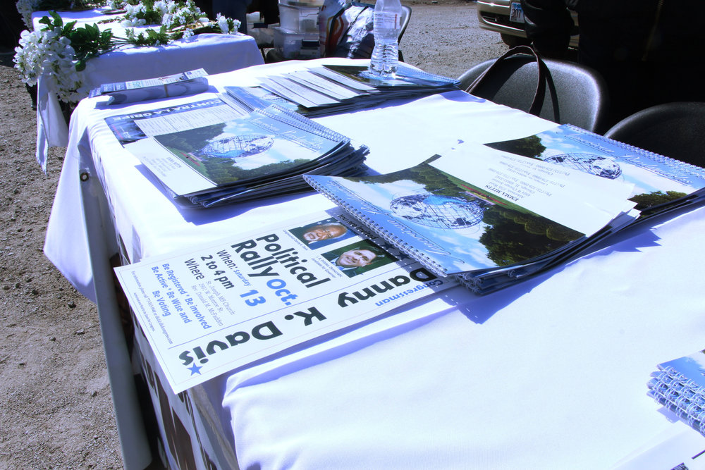 Brochures, calendars, and flyers for placed on Alderman Mitts table for an upcoming rally.