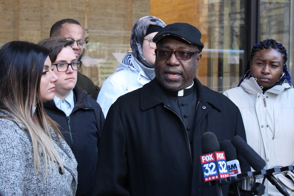 Rev. Charles Straight addresses media members following the Coalition to End Money Bond's meeting with Cook County Chief Judge Timothy C. Evans on Nov. 13. The group is calling for the reassignment of two bond court judges who've shown negligence in assigning unaffordable bonds.  Photo by: Trevor Squire, The Real Chi.