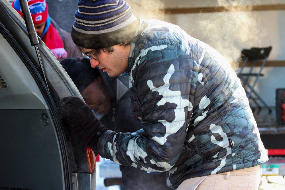 Volunteers helped community members make various repairs on their vehicles.