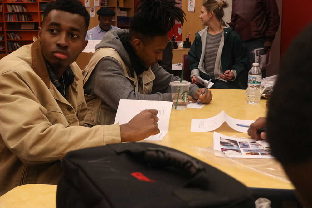 Participants of the simulation fill out documents which were used to determine their next steps. At the beginning of the event, participants were initially provided with only two bus passes.