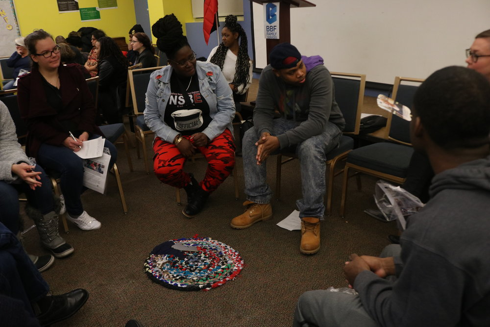 Members of Circles and Ciphers facilitate a peace circle, which they say is a restorative justice tool.