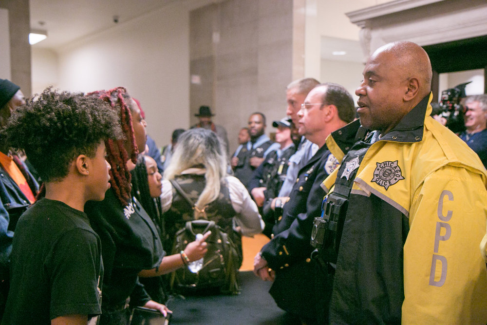 Inside City Hall, #NoCopAcademy organizers were denied entry into public Chicago City Council meeting during vote on police and fire training academy. Photo by Julia Mondschean | The Real Chi