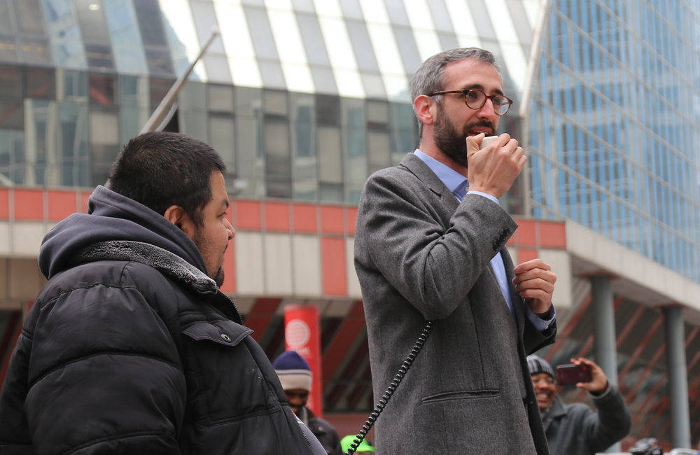 """State Rep. Will Guzzardi (D-Chicago) tells the crowd that the fight for rent control is """"not over."""""""