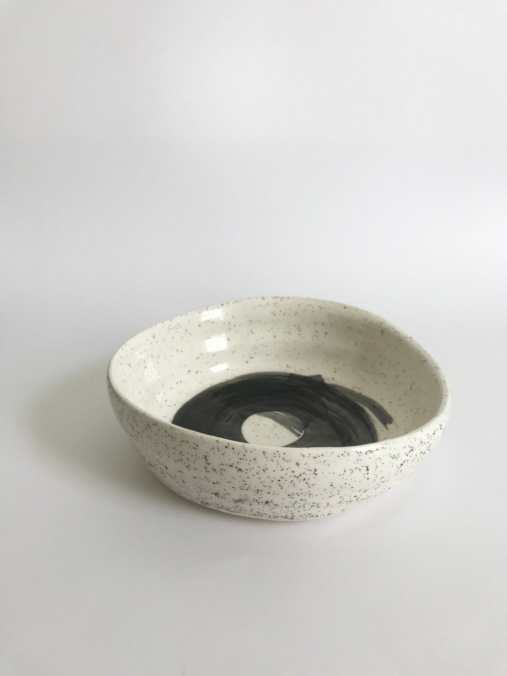 Spin Me Bowl / $30 – SOLD White clay with black sand, black underglaze design and clear glaze