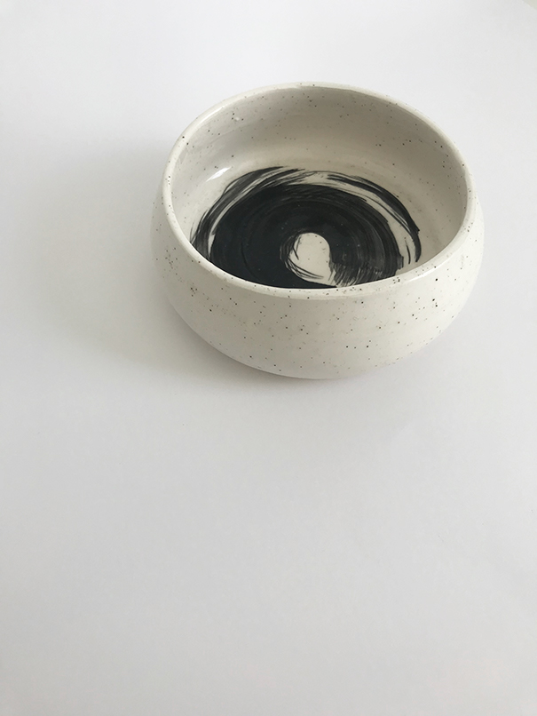 Turn Me Bowl / $30 White clay with black sand, black underglaze design and clear glaze