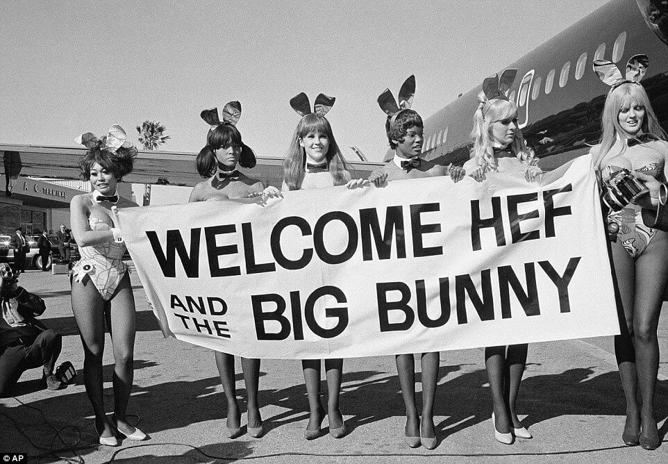 Playboy Bunnies greet Hugh Hefner on the inaugural flight of his new stretch DC-9 private jet, named The Big Bunny - March 17, 1970