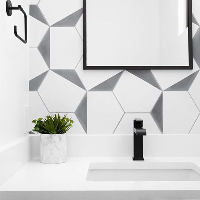 Black matte details at our Live Oak powder room — always the perfect place to splurge on tile.