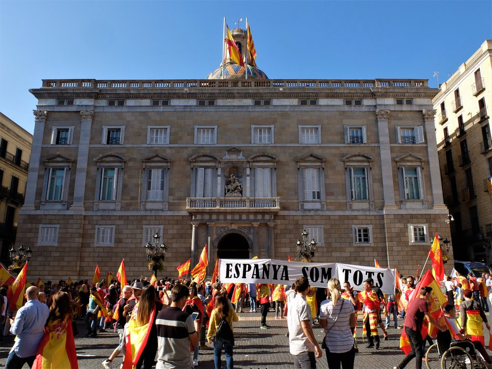 "Protesters carry a banner in front of the Catalan government's office that reads: ""Spain, We Are Together"". Photocredit: Albert Han"