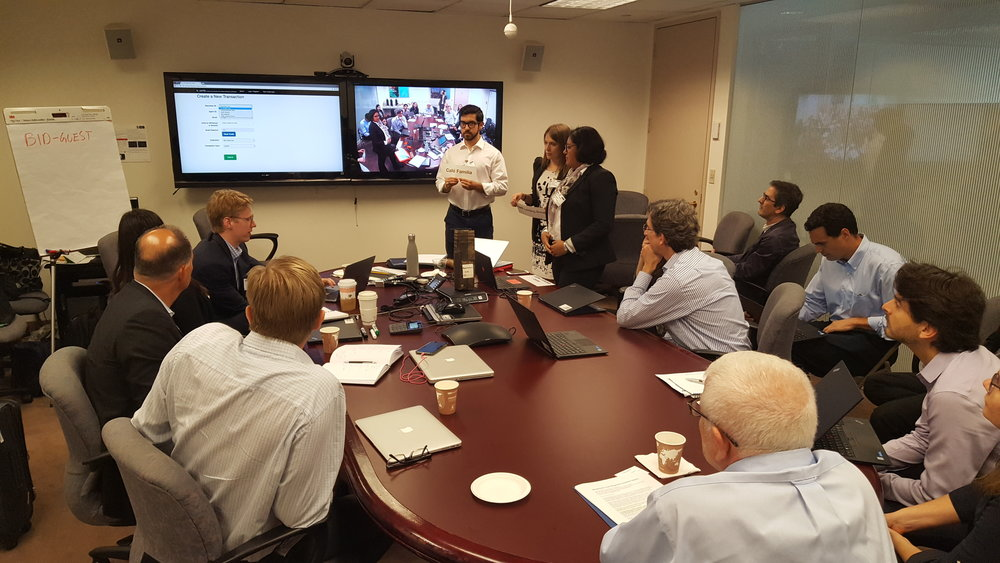 "The ""Asset Registries"" working group performs a role-play demo of the b_verify prototype for inventory-based lending to the Capital Markets Division of the Inter-American Development Bank in Washington DC."
