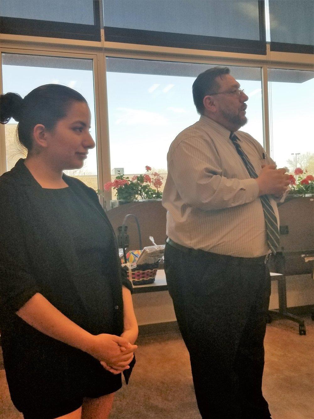 Program facilitators Stephany Murguia-Vega from the Rape Recovery Center and Javier Campos from Centro de la Familia de Utah offering congratulations to the families graduating from the 8 week  Nuestras Familias, Nuestra Salud  program.