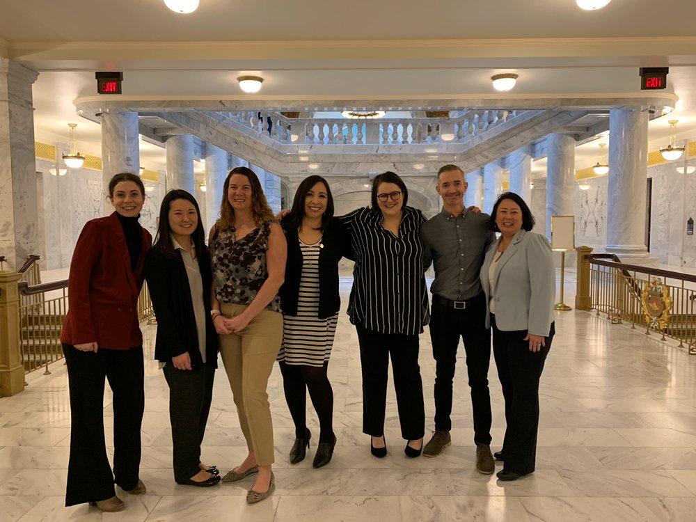 Board and Staff of the Rape Recovery Center pictured with Representatives Angela Romero and Karen Kwan at the Utah State Capitol during our 2019 legislative breakfast.
