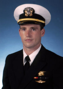 071001-N-0000X-001 Navy file photo of SEAL Lt. Michael P. Murphy, from Patchogue, N.Y. Murphy was killed by enemy forces during a reconnaissance mission, Operation Red Wing, June 28, 2005, while leading a four-man team tasked with finding a key Taliban leader in the mountainous terrain near Asadabad, Afghanistan. The team came under fire from a much larger enemy force with superior tactical position. Murphy knowingly left his position of cover to get a clear signal in order to communicate with his headquarters and was mortally wounded while exposing himself to enemy fire. While being shot and shot at, Murphy provided his units location and requested immediate support for his element. He returned to his cover position to continue the fight until finally succumbing to his wounds. U.S. Navy photo (RELEASED)