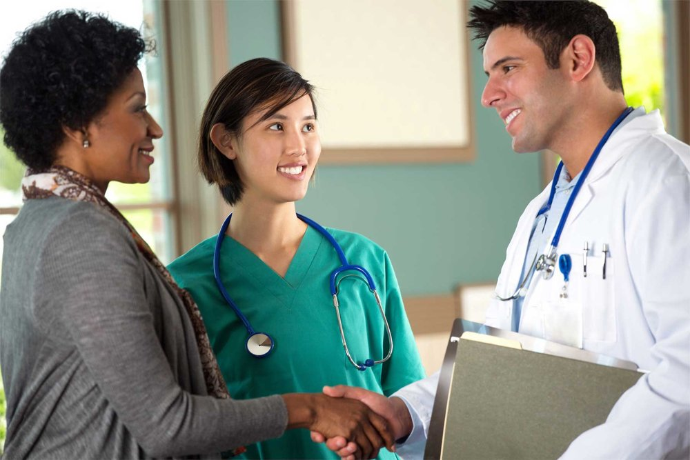 Health care team speaking with a patient.sweat2much_blog images.jpg