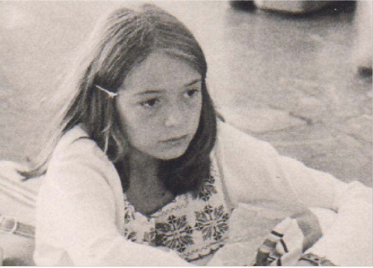 Photo taken in 1974, age 11, by trafficker months before release from the network.