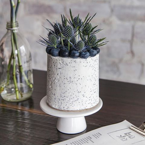 Blueberry and Poppy - Lime almond cake, with coconut creme and poppy seed design.Blue nettle and fresh blueberry garnish.