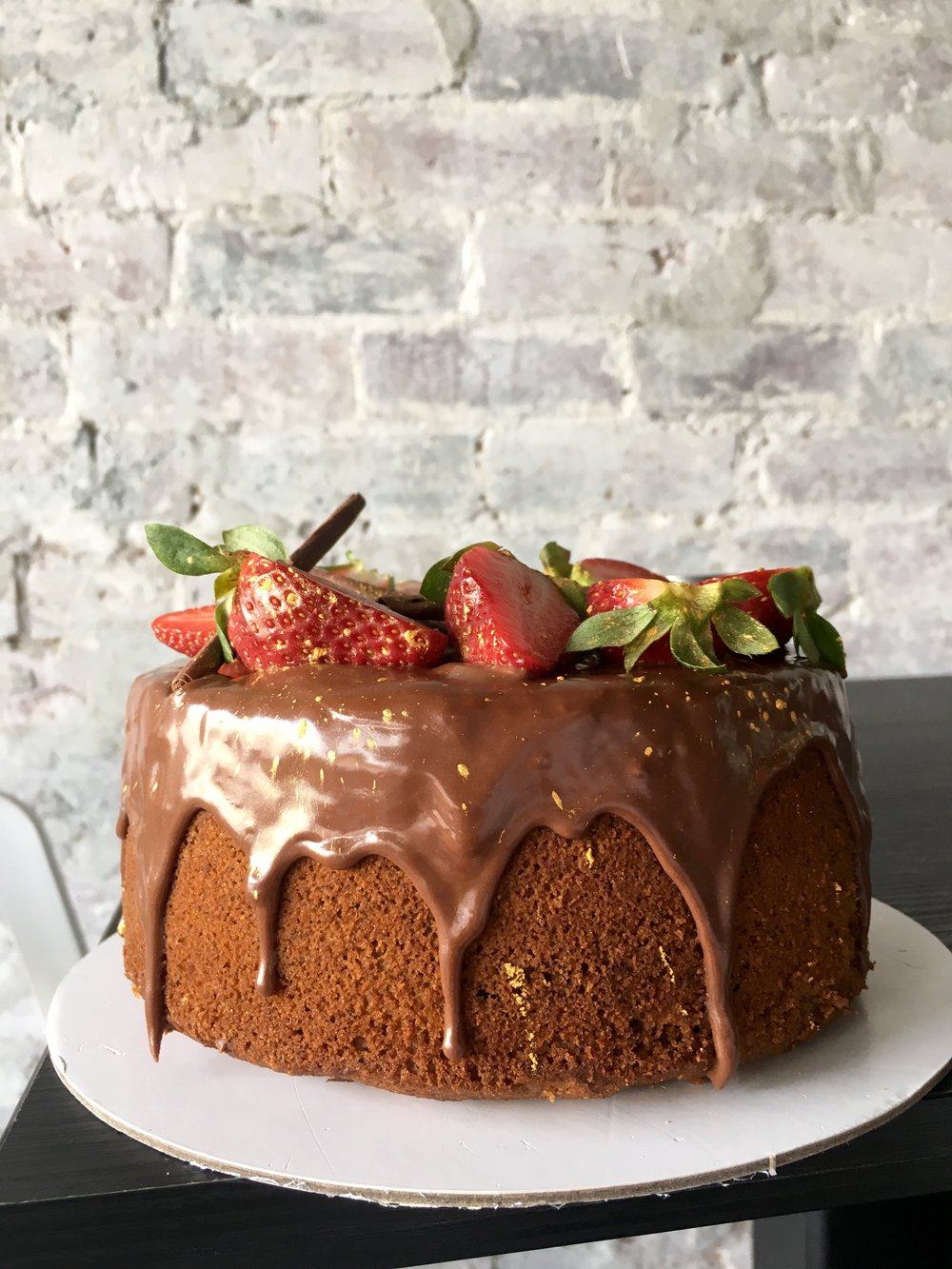 Chocolate strawberry - Light super fluffy chocolate chiffon cake, with centre of strawberry coulis, chocolate coconut ganache and fresh berries.
