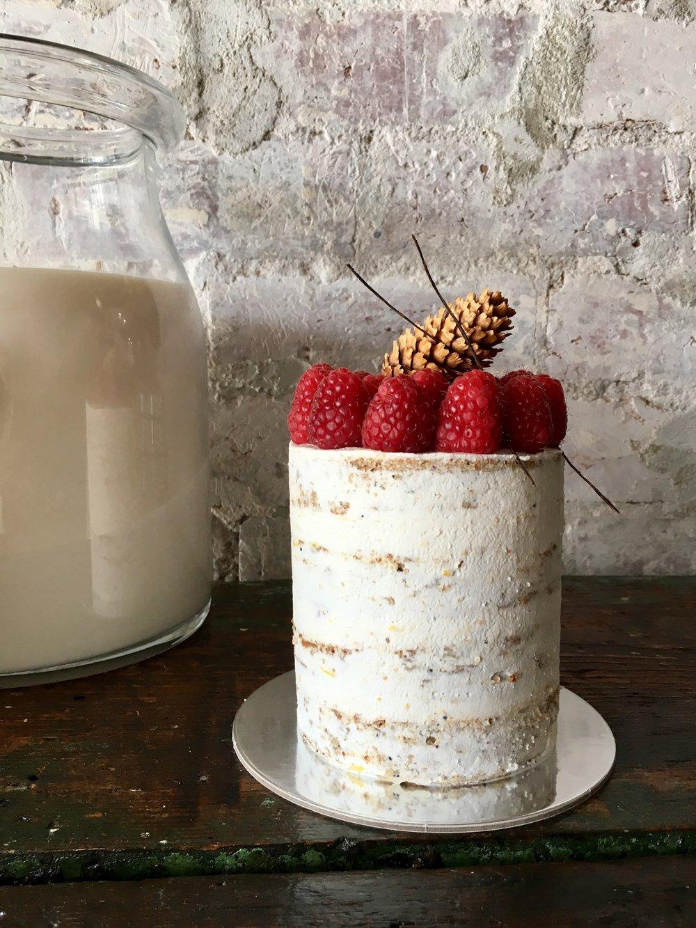 Vegan Lemon Poppy - Delicate soft cake crumb, favoured with freshly zested lemon, raspberries and vegan coconut creme exterior.Semi naked finish.