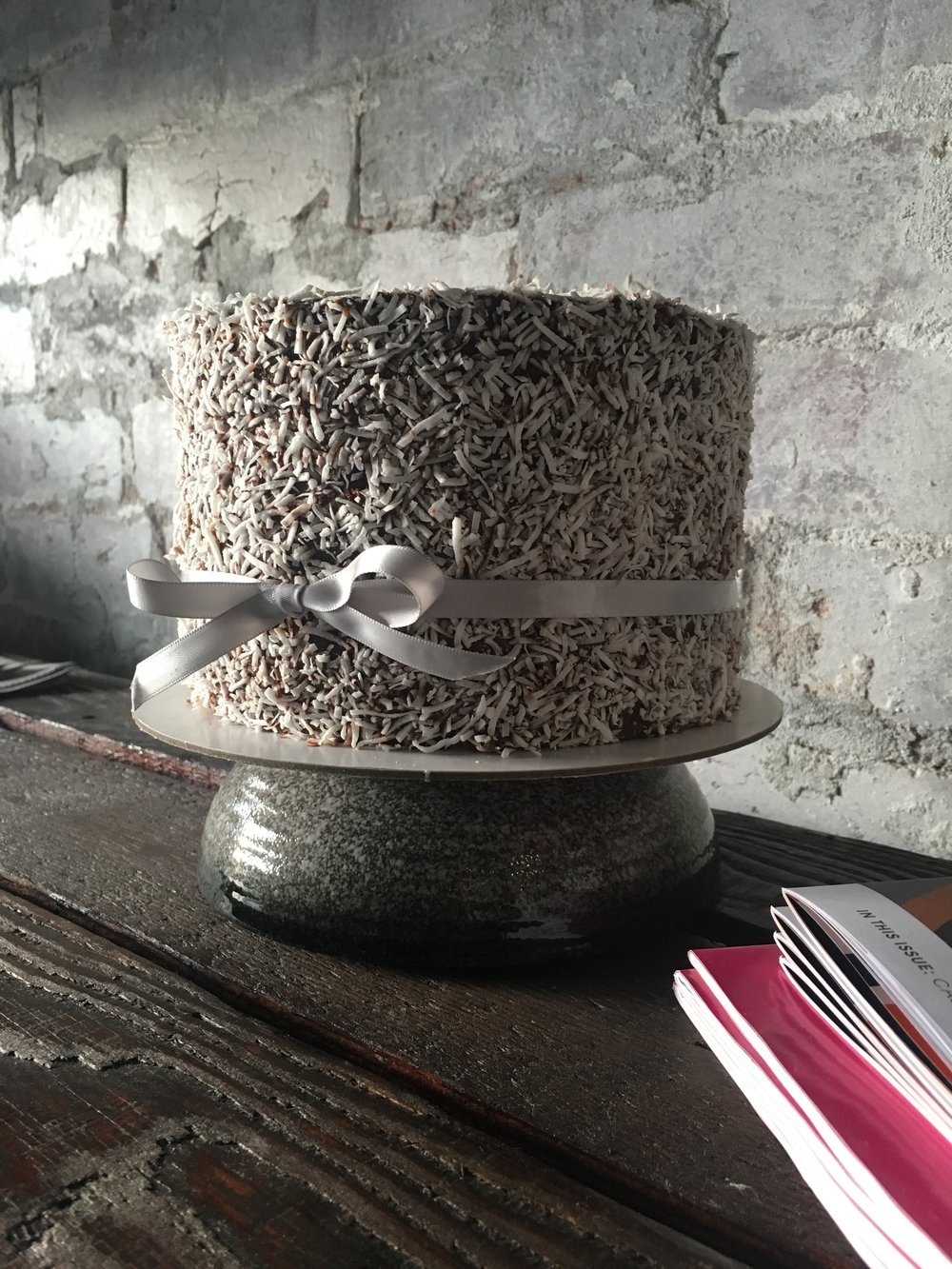 Lamington Cake - Layers of chocolate and vanilla sponge, house made jam, finished with chocolate ganache and coconut,