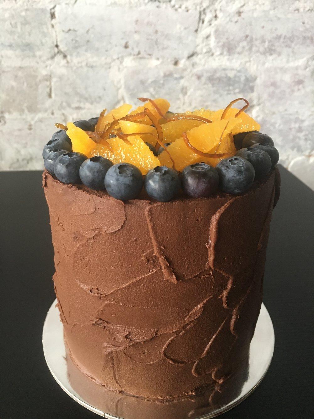 Vegan Jaffa - Almond and orange cake, with velvety chocolate ganache and fresh orange and blueberry. Rustic exterior.
