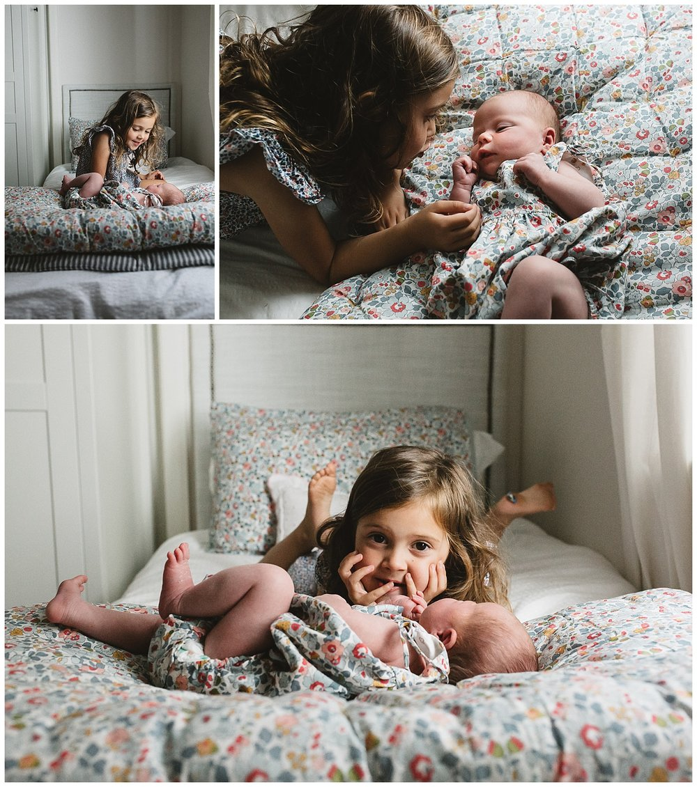 Camberwell baby and toddler photography. Siblings looking at each other in bed.