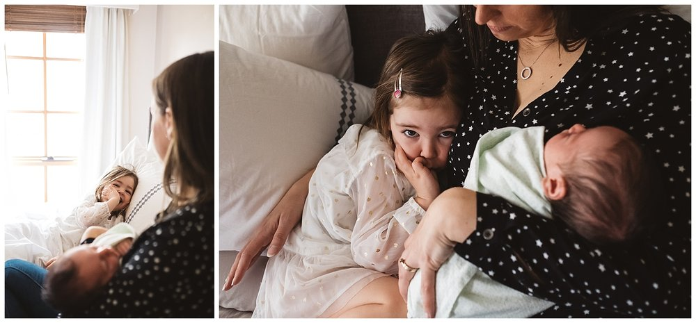 Relaxed family photography in Brighton, newborn baby held by mum while cuddling a toddler in bed