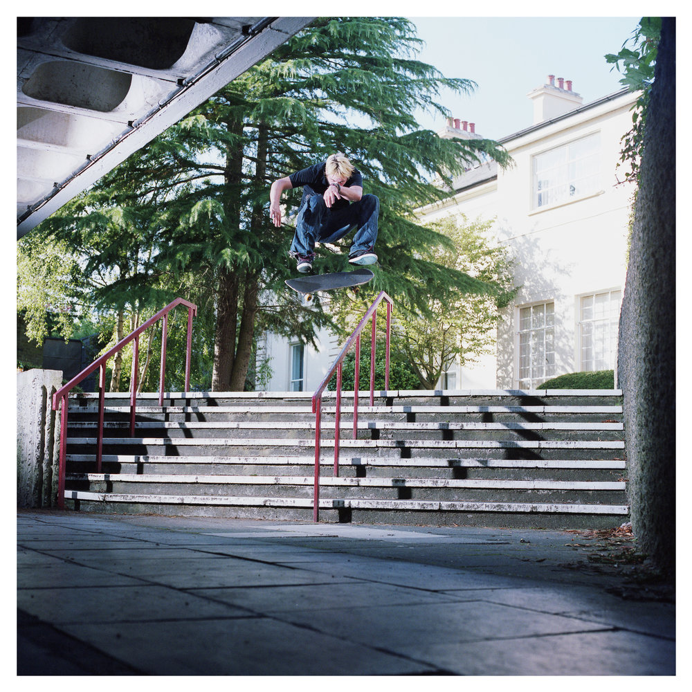 Conor Benson frontside flip over the Vic Rail - Victoria College.  Published in issue 3 of North Skate Mag.