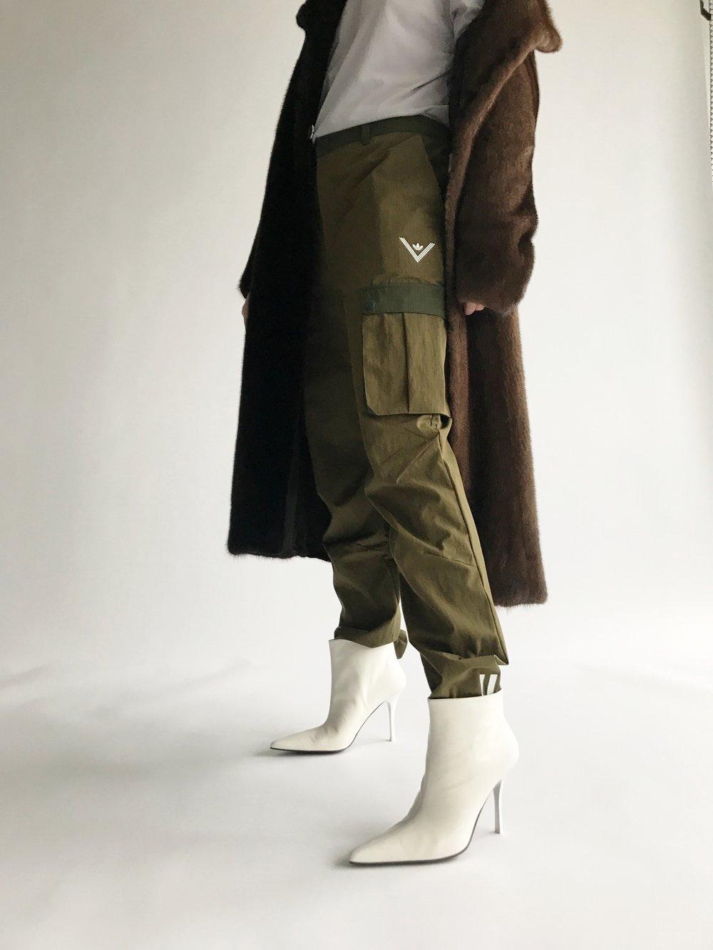 Fur: Freja Dalsjø, shirt: Nike, pants: Adidas, shoes: Celine