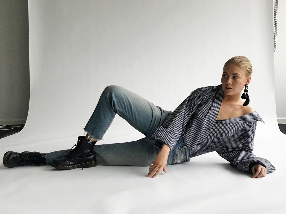 Jeans: Lewis, books: Doc Martens, shirt: Balenciaga, earrings: By Malene Birger (showpiece)