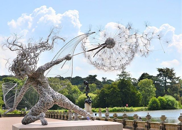 'Dramatic Fairy Sculpture Dancing With Dandelion' By Robin Wight  Robin Wight, a UK-based sculptor that works primarily with stainless steel wire, has mastered the creation of enchanting and dynamic fairy sculptures that seem to dance in or struggle against the wind. ____________________________________________________________ #71STRUCTURALART #71SA #RobinWight #Steel #SteelSculpture #Fairy #Dandelion #Monumental #MonumentalArt #AlserkalAvenue #MonumentalSculpture #Sculpture #Sculptor #Sculpt #Sculptures #SculptureArt  #SculptureOfTheDay #Art #Artist #ContemporaryArt #FineArt #ArtOfTheDay #ModernArt  #ArtGallery #BronzeSculpture #Gallery #ArtDubai  #AbuDhabiArt #UAE