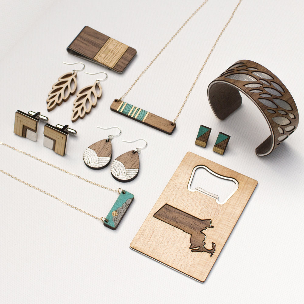 JOYO JEWELRY   We're a small design studio in Scituate MA, run by husband and wife team, Damian and Jenn Liddiard. Our line of modern wood jewelry, accessories, and small home goods combines Jenn's background in graphic design and jewelry fabrication and Damian's background as an architect.