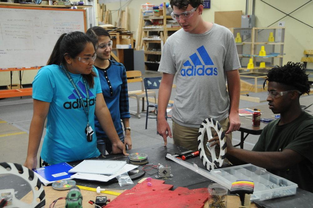 Engineers discussing robot design