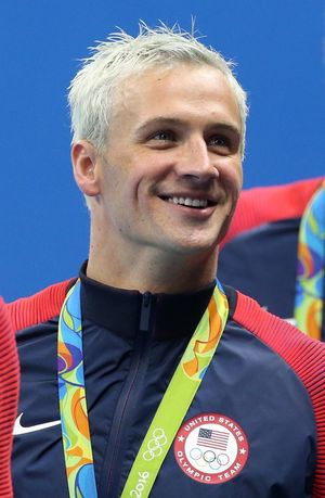 RIO DE JANEIRO, BRAZIL - AUGUST 9: Ryan Lochte of Team USA celebrates winning the gold medal during the medal ceremony of the men's 200m freestyle relay on day 4 of the Rio 2016 Olympic Games at Olympic Aquatics Stadium on August 9, 2016 in Rio de Janeiro, Brazil. (Photo by Jean Catuffe/Getty Images)