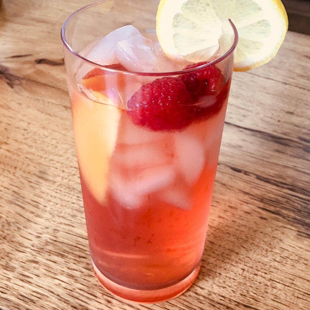 Cold-Brewed Ginger Peach tea with fresh raspberries, peaches, and lemon