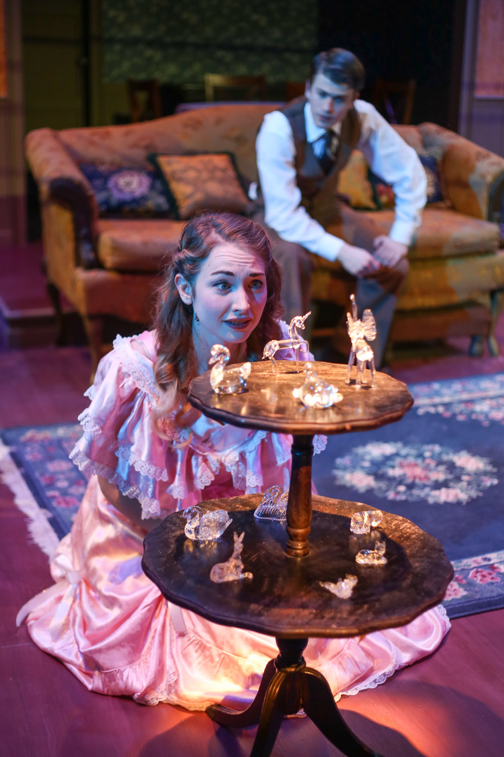 Actress Courtney Shephard as Laura Wingfield staring at her glass menagerie