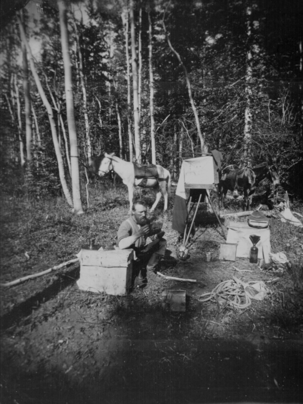 Photographer John K. Hillers, namesake of Mount Hillers, with his portable darkroom, 1872. Image in care of the National Archives.