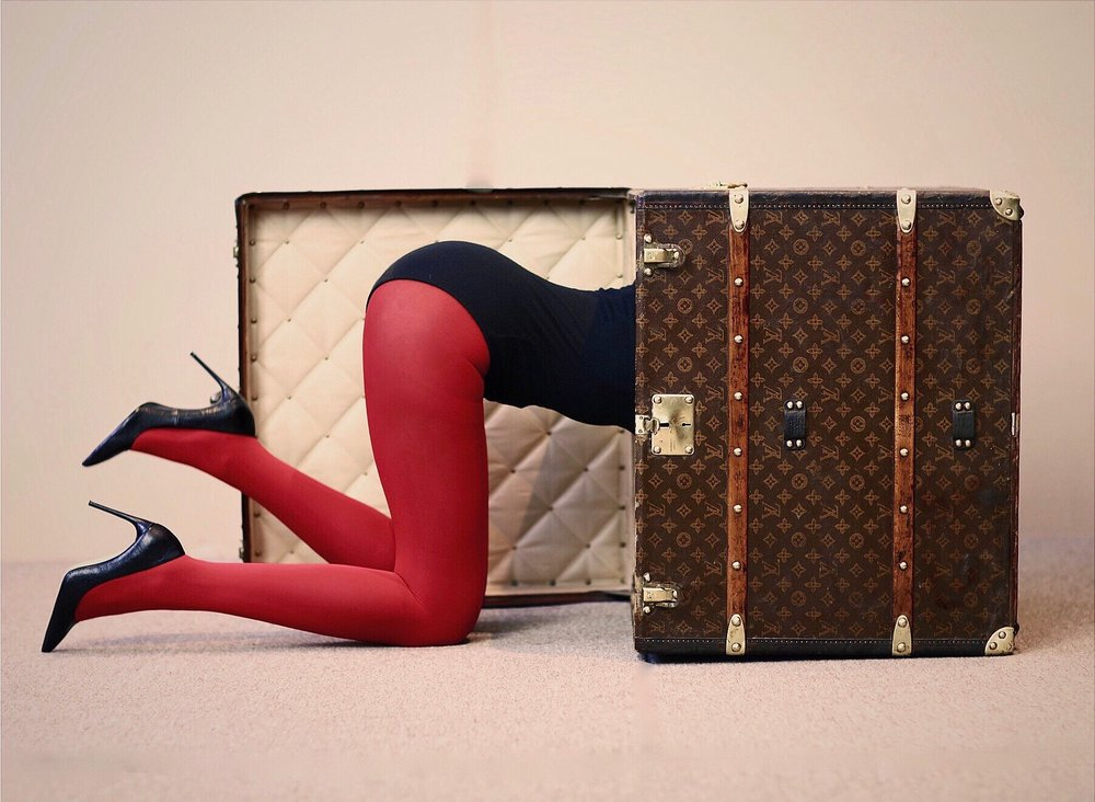 Model Climbing into a Well Traveled Trunk Piece.jpg
