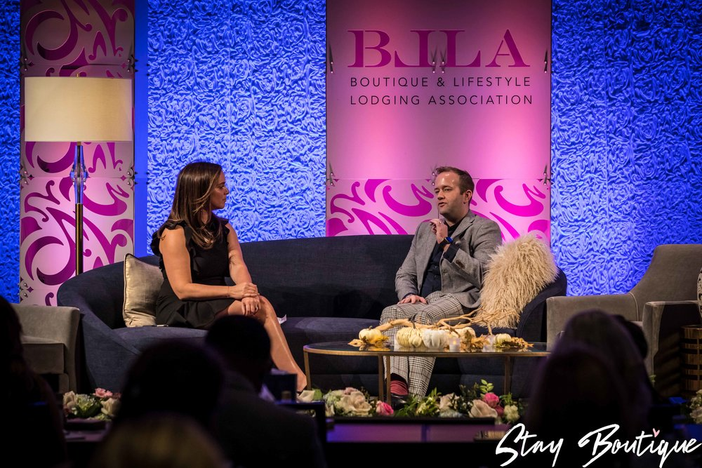 Tim on stage at the 2017 Stay Boutique Leadership Conference.jpg