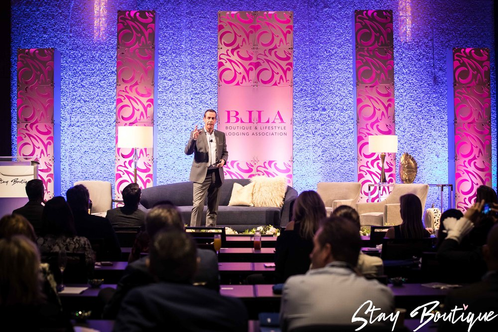 Bill speaking at the 2017 Stay Boutique Conference.jpg