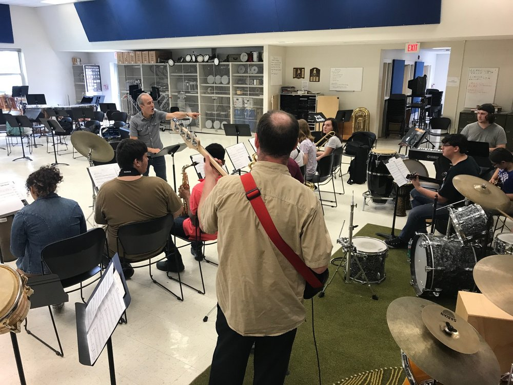 Bobby Previte leading the Schenectady Arts High School through a composition