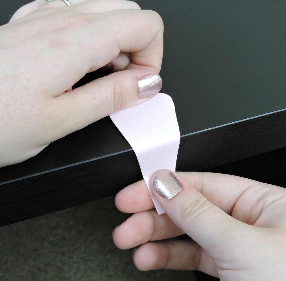 - Step 5:Pull you petal back and forth over a sharp edge (like a desk or table edge) back side down 2 to 3 times. This will make the paper curl. Note: Some patterns will not need to be curled.