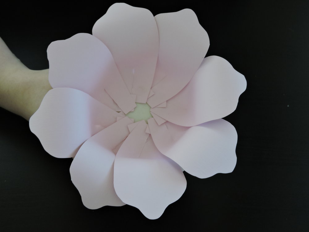 - After the row has been placed you can glue down all of the unattached edges to square the petals off, or leave them unattached to give the petals some twist.