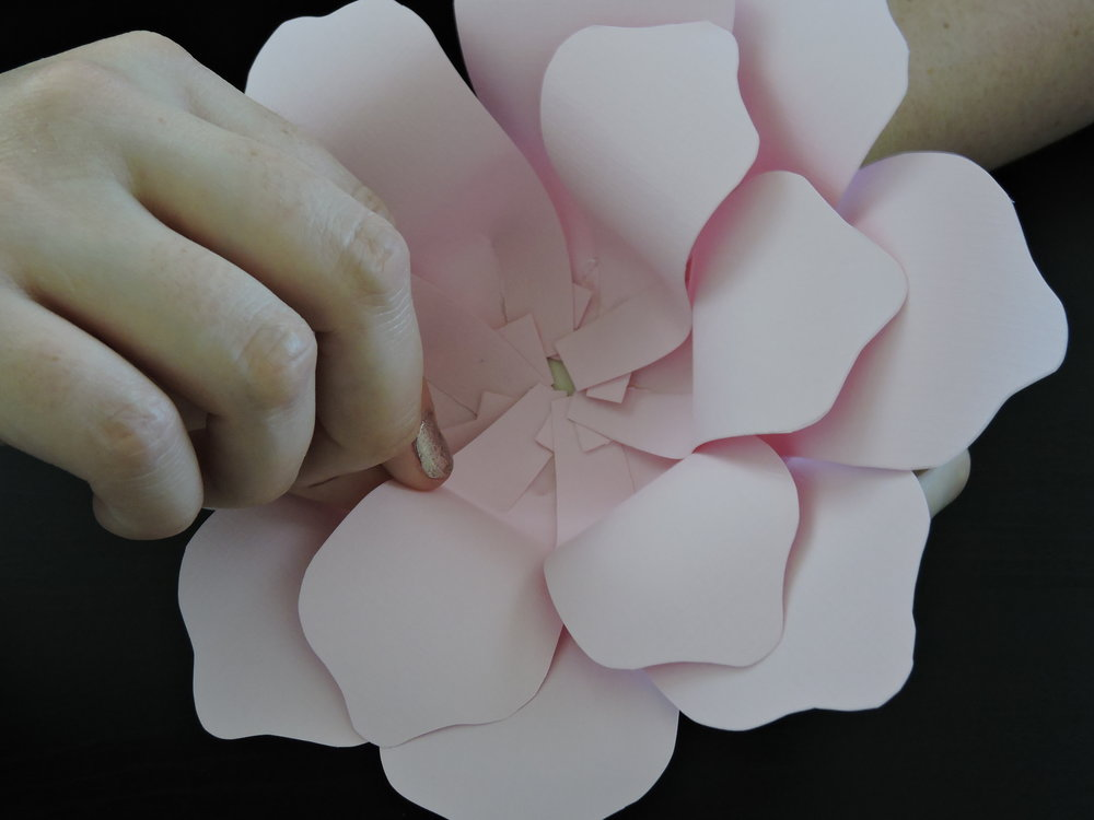 - Follow step 8 and add the remaining petals for the second layer.