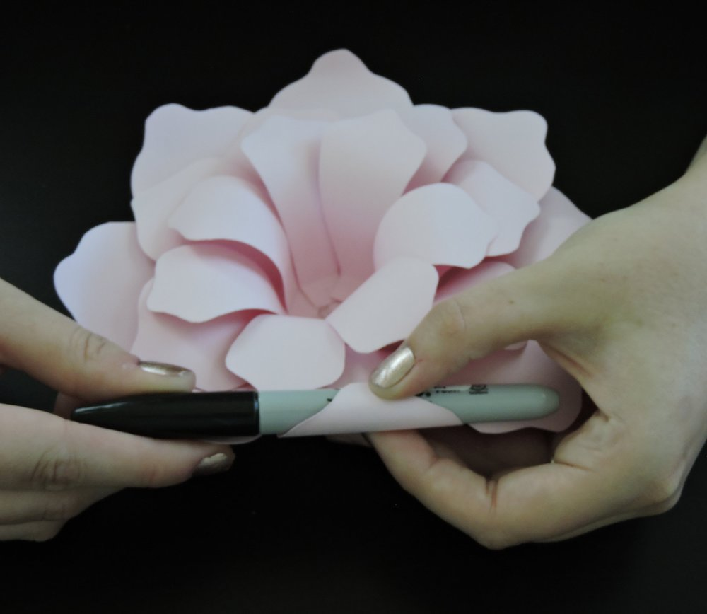- Step 12:Use the sharpie (or other round object) to fold back the petals and create dimension. A good rule of thumb is to back curl the front edges (not behind another petal) of the petals at a diagonal angle.